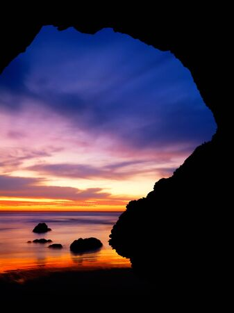 A natural arch along the Pacific coastline near Santa Barabara, California.  Image made during an extreme low tide at sunset. Stock Photo - 10533705