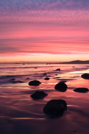 california beach: A sunset during low tide along Butterfly Beach in Santa Barbara, CA.