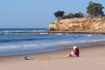 santa barbara: A young woman is enjoying a morning at Leadbetter Beach in Santa Barbara, California. Stock Photo