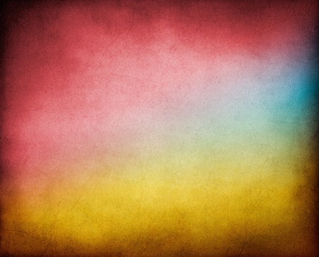 A vintage, textured paper background with multicolored gradients.  Image has a pleasing paper texture and grain pattern visible at 100%. Stock Photo