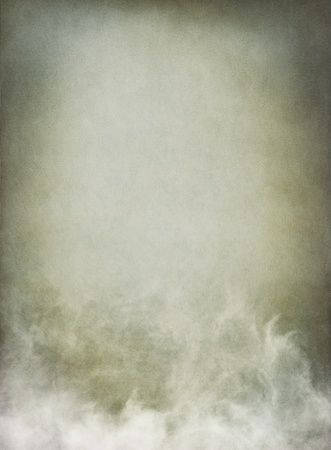 Fog, mist, and clouds with subtle gray tones.  Image has a pleasing paper texture and grain pattern visible at 100%.