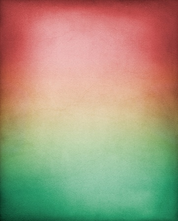 A vintage paper background with a red to green gradient.  Image has a pleasing grain texture at 100%. photo