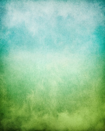 pleasing: Fog, mist, and clouds with a green to blue gradient.  Image has a pleasing paper texture and grain pattern visible at 100%. Stock Photo