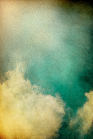 Sunlight shining through textured vintage clouds.  Image has a pleasing paper grain and texture at 100%. Stock Photo - 11450041