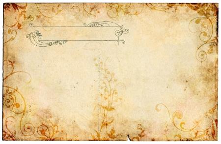 hojas antiguas: Una postal de 100 años de antigüedad con un diseño floral del grunge y las manchas. Foto de archivo