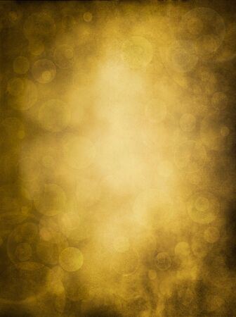Glowing bokeh effects on a textured paper background.  Image has a pleasing grain pattern at 100%. photo