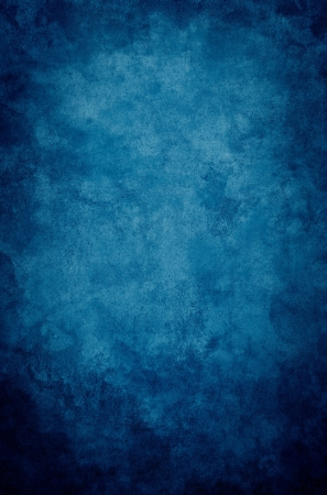 mottled: A textured, vintage paper background with a dark blue vignette. Stock Photo