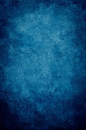 Een textuur, vintage papier achtergrond met een donker blauwe vignet.