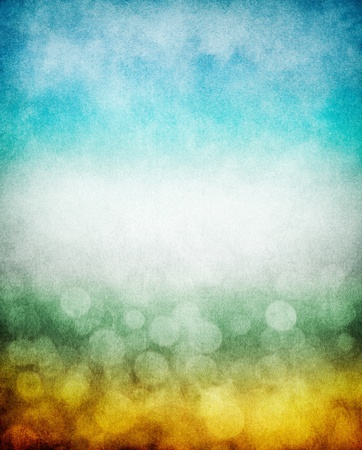 pleasing: Fog, mist, and clouds with a yellow to blue gradient and boken effects.  Image has a pleasing paper texture and grain pattern visible at 100%. Stock Photo