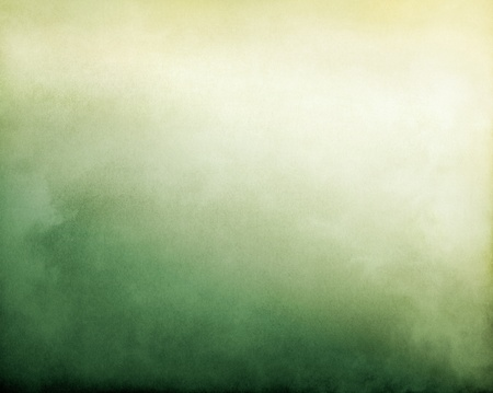 Fog and clouds on a green to yellow textured gradient background.  Image displays a pleasing paper grain and texture at 100%.  Archivio Fotografico
