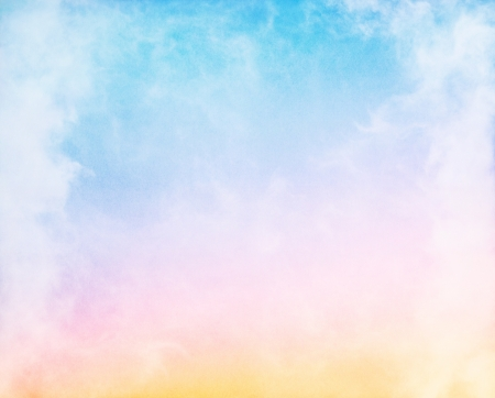 Fog and clouds on a colorful rainbow blue to orange gradient. Image displays a pleasing paper grain and texture at 100%.