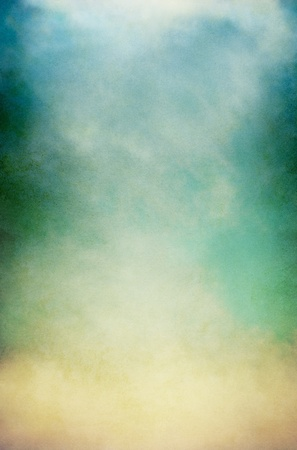 blue background: Fog, mist, and clouds on a vintage, textured paper background with a color gradient. Image has a pleasing paper grain pattern at 100%. Stock Photo