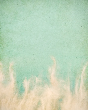 pleasing: Wispy spring clouds on a textured, vintage background with grunge stains.  Image has a pleasing paper grain pattern at 100%. Stock Photo