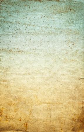 Antiguo papel arrugado con un gradiente de la vendimia de color, manchas grunge, y la textura granulada. Foto de archivo - 13549290