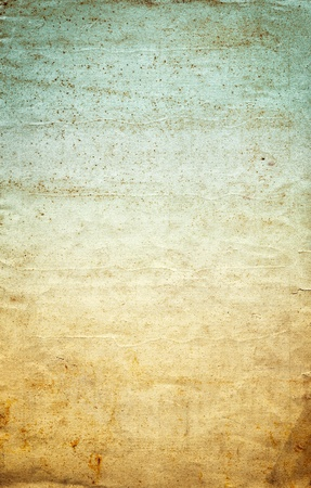 Old wrinkled paper with a vintage colored gradient, grunge stains, and grainy texture.