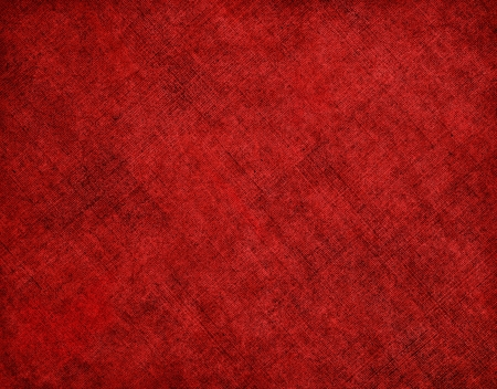diagonal lines: An old cloth book cover with a diagonal red crosshatch pattern and grunge stains.  Image has a pleasing grain texture at 100%. Stock Photo