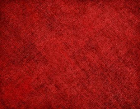 Un trapo viejo libro de tapa con un patrón de líneas cruzadas en diagonal de color rojo y manchas grunge. La imagen tiene una textura de grano agradable al 100%. Foto de archivo - 13643194