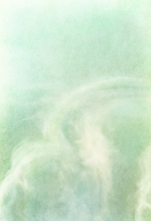 Ethereal and wispy clouds on a textured vintage paper background.  Image has a pleasing paper grain and texture visible at 100%. Stock Photo - 16441501