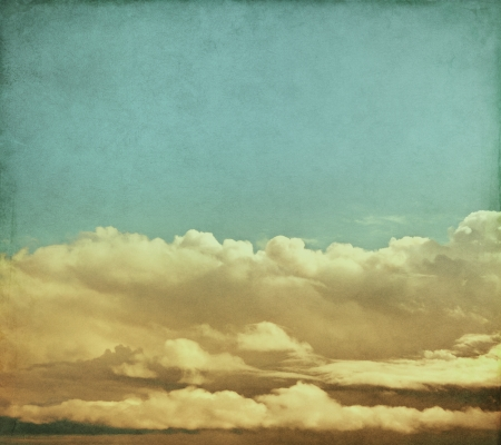 Winter storm clouds rendered with vintage colors   Image has a pleasing paper grain and texture