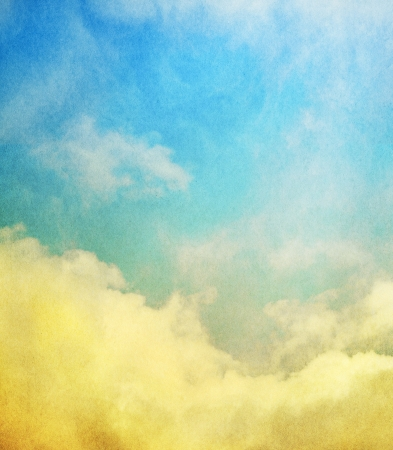 Fog, mist, and clouds with a yellow to blue gradient   Image has a textured paper overlay and grain pattern visible at 100   photo