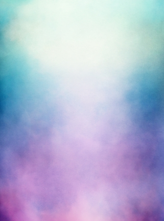 An abstraction of clouds and fog with a purple to green gradient   Image displays a distinct paper texture and grain at 100   Stock Photo
