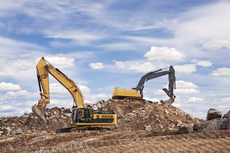 mining machinery: Two backhoes excavating a constuction site