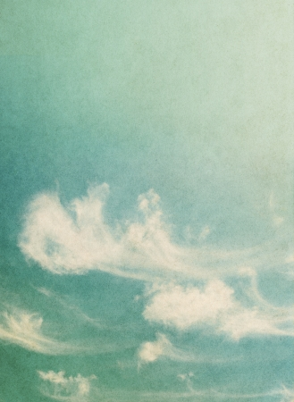 Ethereal and wispy clouds on a vintage paper background   Image has a pleasing paper grain and texture  Banco de Imagens