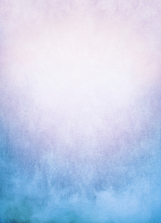 A background image of fog, mist, and clouds with a colorful blue to pink gradient   Image has significant texture and grain visible at 100   Stock Photo