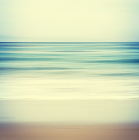 An abstract ocean seascape with blurred panning motion   Image displays a retro, vintage look with cross-processed colors