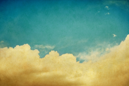 Sky and billowing clouds on a vintage paper background with retro colors   Image displays a pleasing paper grain and texture when viewed at 100 percent