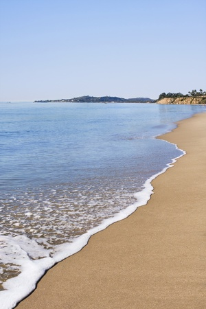 santa barbara: Butterfly Beach in Santa Barbara on a very calm day with Leadbetter Point in the distant background