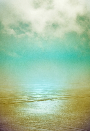 grunge cross: Sand and flowing ocean water disappearing into the horizon with swirling fog above   Image displays a pleasing grain pattern at 100 percent