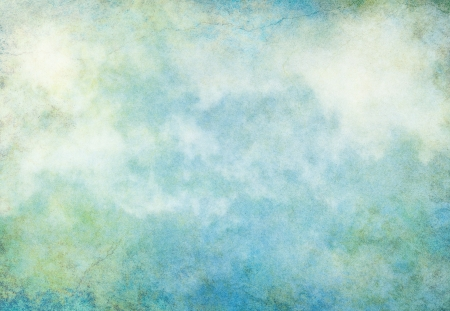 A textured background with turquoise, yellow and green grunge patterns overlaid with fog and clouds.  Image displays a pleasing paper grain at 100 percent. Reklamní fotografie