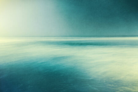 An abstract ocean seascape with blurred panning motion   Image displays a retro, vintage look with cross-processed colors and a pleasing paper grain and texture