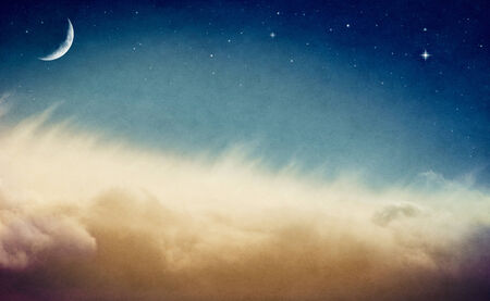 crescent: A crescent moon and stars rising above misty fog and clouds   Image is done in retro colors and exhibits a pleasing paper grain and texture at 100 percent
