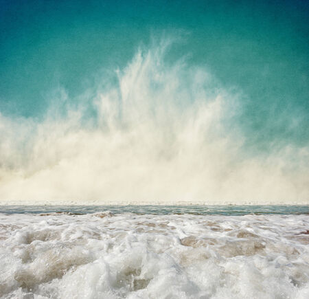 Ocean waves with fog rising at the horizon.  Image displays a pleasing grain texture at 100 percent. Stock Photo - 23924681