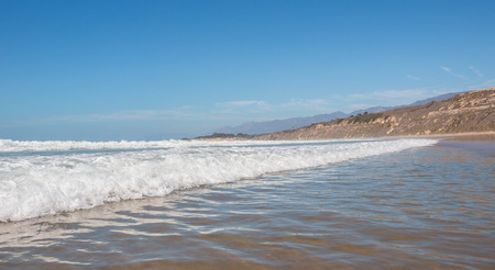 An incoming wave and whitewater at Rincon Park near Santa Barbara, California. photo