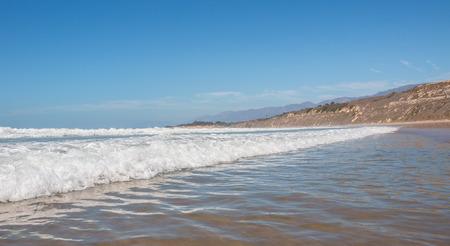 santa barbara: An incoming wave and whitewater at Rincon Park near Santa Barbara, California.
