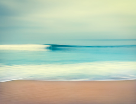 An abstract seascape with blurred panning motion   Image displays a retro, vintage look with cross-processed colors