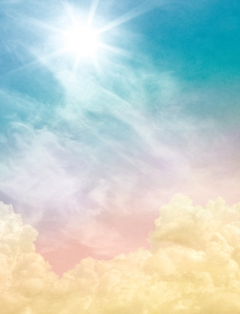 displays: Billowing and wispy clouds with a sunburst light effect   Image displays soft, pastel colors and a paper grain and texture at 100 percent  Stock Photo