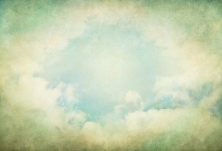Vintage fog and clouds with glowing green and yellow colors   Image displays a pleasing paper grain and texture at 100    photo