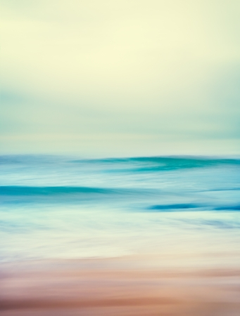 An abstract seascape with blurred panning motion and long exposure   Image displays a retro, vintage look with cross-processed colors