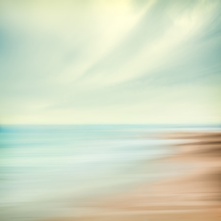 A seascape abstract with panning motion combined with a long exposure   Image displays soft, pastel colors in a retro style  Stock Photo