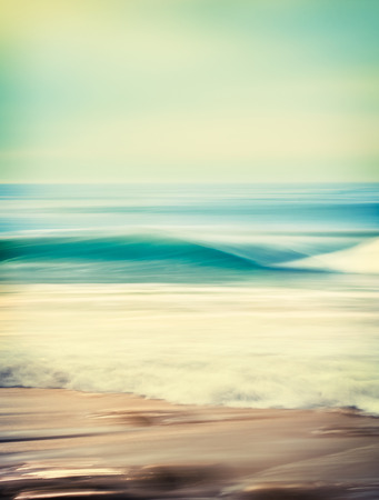 cross processed: An abstract seascape with blurred panning motion combined with a long exposure   Image displays a retro, vintage look with cross-processed colors   There