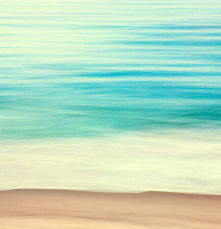 An abstract ocean seascape with blurred panning motion   Image displays a retro look with cross-processed colors  photo