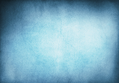 grunge textures: A blue and cyan grunge background with heavy paper textures and a glowing center.  Image has crack patterns and significant grain.