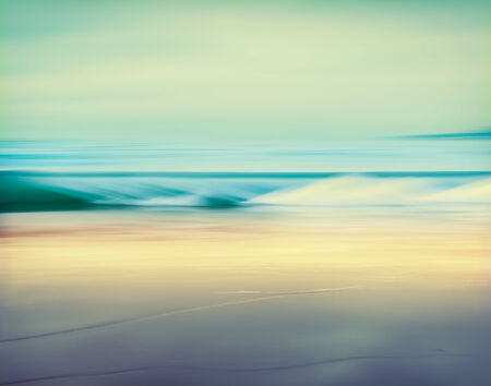 An abstract seascape made with a long exposure   Image displays a retro, vintage look with cross-processed colors