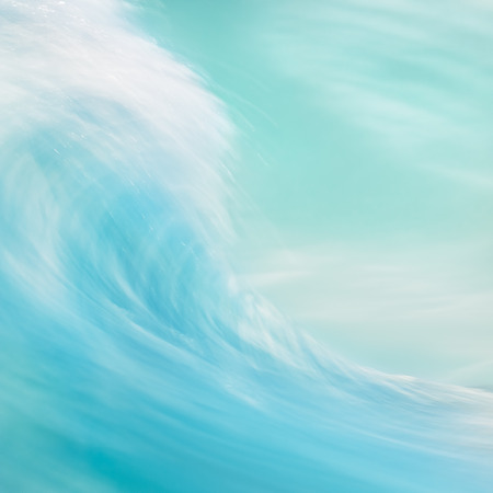 turquoise water: A long exposure abstraction of an ocean wave breaking onshore.