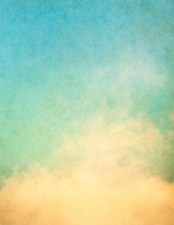 Yellow clouds and fog on a vintage, textured background with a subtle color gradient.  Image displays significant paper grain and texture at 100 percent. photo