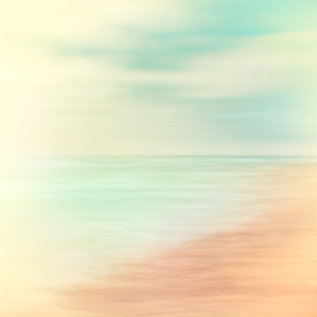 soft colors: A seascape abstract made with panning motion combined with long exposure.  Image displays soft contrast with split-toned colors.